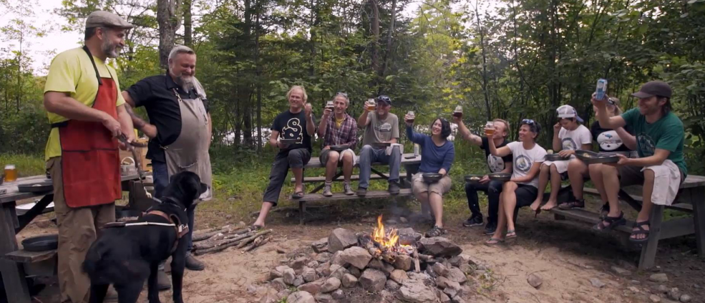 Ottawa River Champions, Lawrence and featured Chef Steve Mitton sit around the camp fire