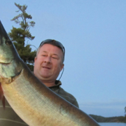 Photo of Todd holding a Muskie