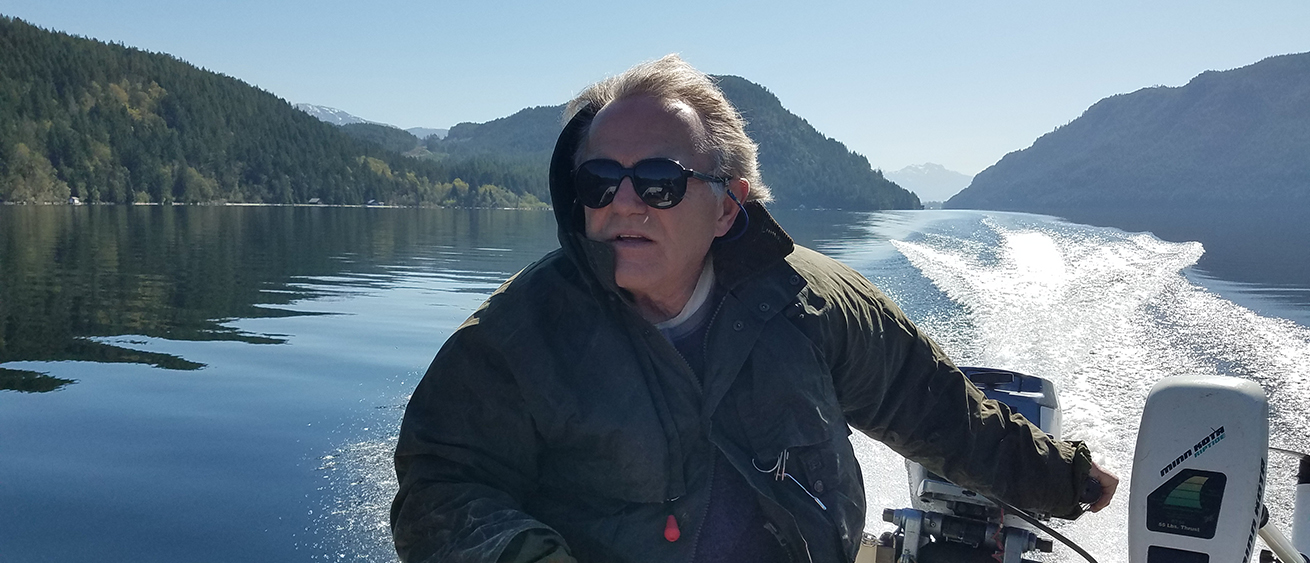 Photo of Brian Tutty in his boat out on a lake
