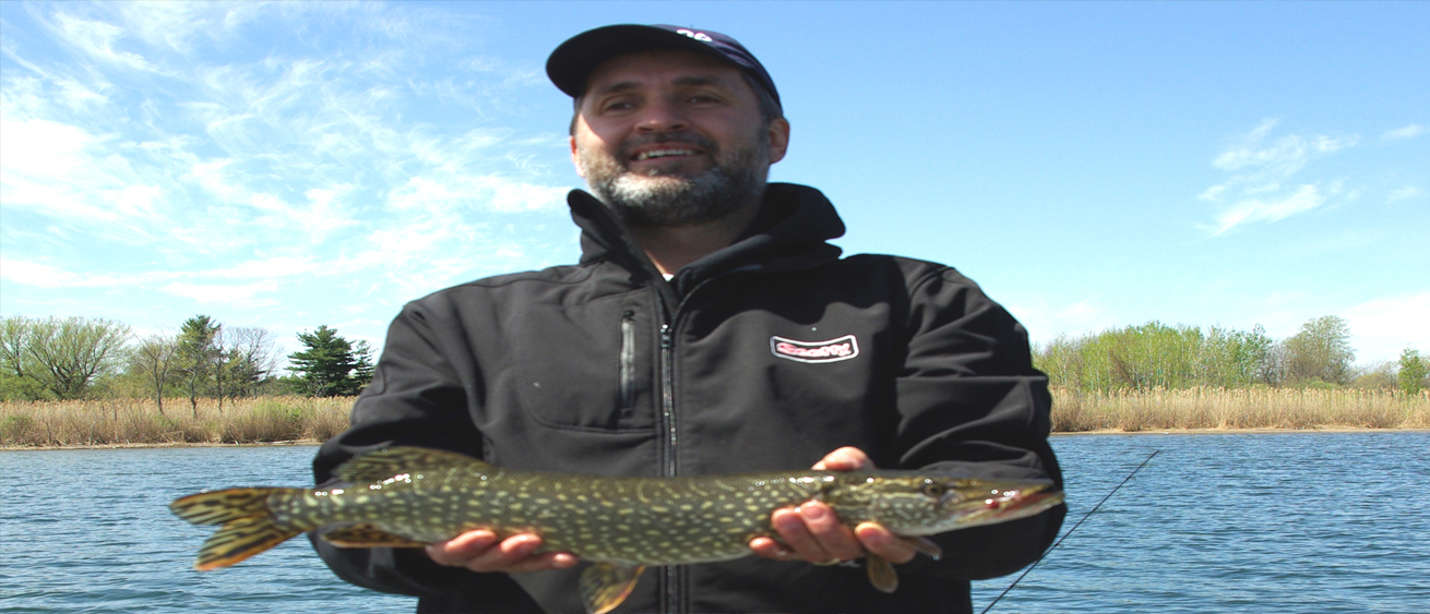 Lawrence holding a pike